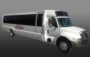 white-limo-bus